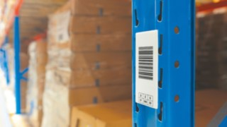 The Linde Material Handling warehouse navigation system uses barcodes on the racks.
