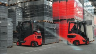 Linde forklift with LED spotlight driving in a warehouse with load