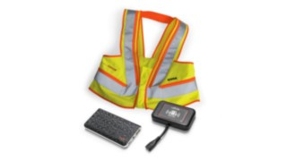 Interactive warning vest, wearable unit, and truck unit