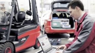 A service technician services a Linde forklift truck