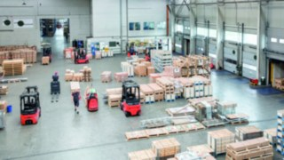 Warehouse with forklifts in operation