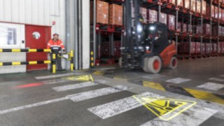 The Linde Safety Guard warns pedestrians of an approaching forklift truck by projecting a symbol onto the floor.