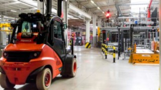 A forklift truck by Linde Material Handling waits at a Linde Safety Guard traffic light in the plant operated by Coca-Cola European Partners France.