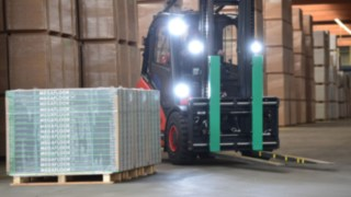 Linde electric forklift truck moving materials