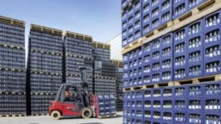 Linde's X35 electric forklift truck transports crates of Ensinger drinks outdoors