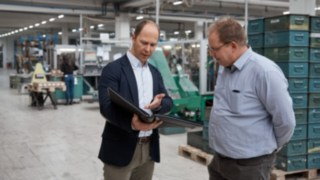 Employees of Reinheim-based Grass GmbH in conversation