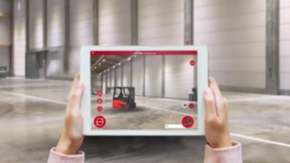 The Virtual Showroom app from Linde Material Handling projects an E16 into the surrounding warehouse on the tablet screen.