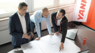 Experts from Linde Material Handling join forces to plan the Yanmar Compact Equipment Europe logistics center.