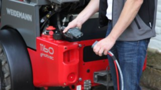 Linde electric forklift truck charging.