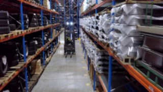 Still from the video on R14 – R17 X reach trucks in operation in mobile shelving system for tires at Formel D
