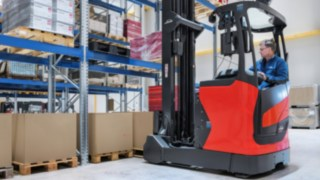 Employee stores goods in a Linde Material Handling vehicle.